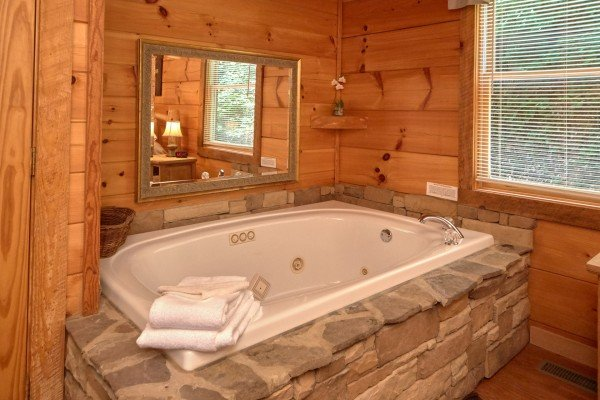 Jacuzzi in the bedroom area at Wild Crush, a 1 bedroom cabin rental located in Pigeon Forge