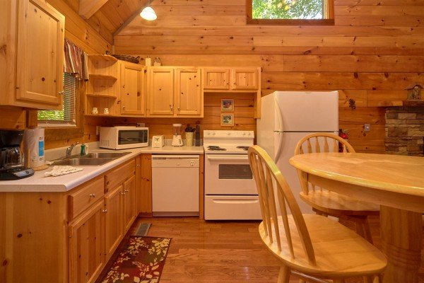 Kitchen with white appliances at Wild Crush, a 1 bedroom cabin rental located in Pigeon Forge