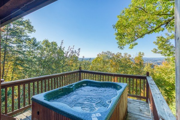 Hot tub on the deck with a mountain view at Apple View, a 2 bedroom cabin rental located in Pigeon Forge
