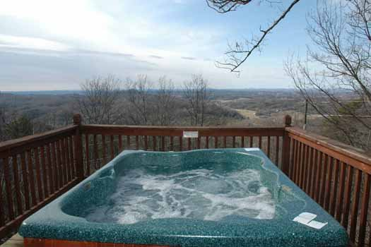 Enjoy the views from the hot tub at apple view a 2 bedroom cabin rental located in pigeon forge