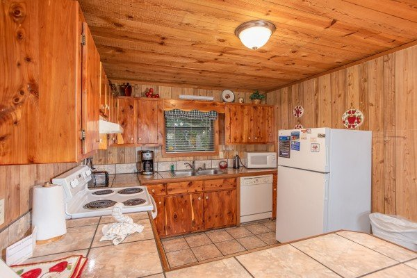 Kitchen with white appliances at Apple View, a 2 bedroom cabin rental located in Pigeon Forge