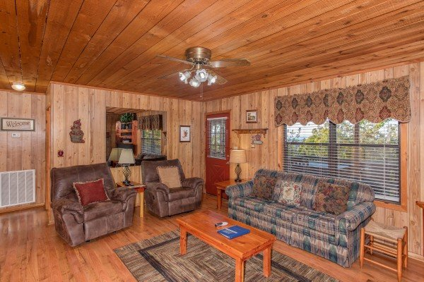 Living room with two recliners and a couch at Apple View, a 2 bedroom cabin rental located in Pigeon Forge