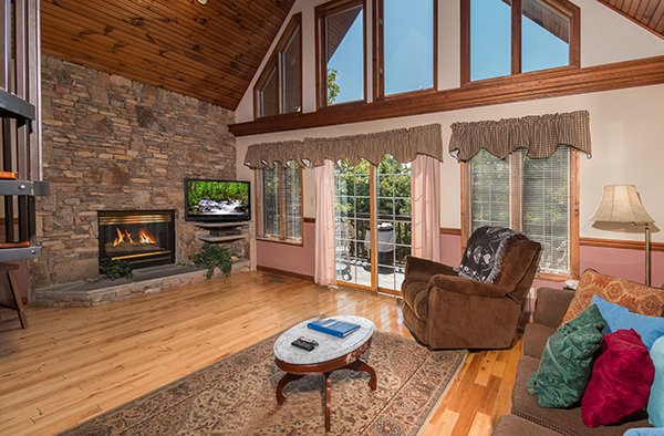 Stacked stone fireplace at Ain't Misbehaven, a 1 bedroom cabin rental located in Pigeon Forge