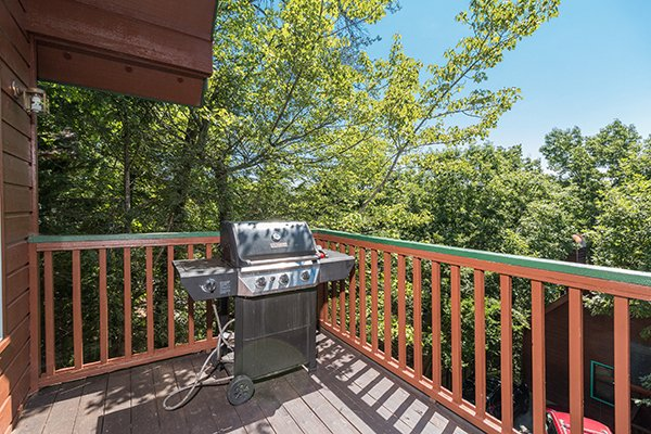 Grill on an upper deck at Ain't Misbehaven, a 1 bedroom cabin rental located in Pigeon Forge