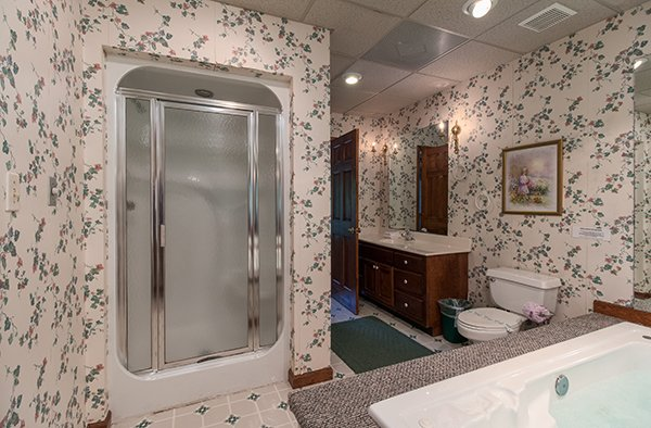 Walk in shower in a bathroom at Ain't Misbehaven, a 1 bedroom cabin rental located in Pigeon Forge