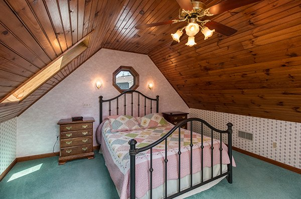 Bedroom with vaulted ceiling at Ain't Misbehaven, a 1 bedroom cabin rental located in Pigeon Forge