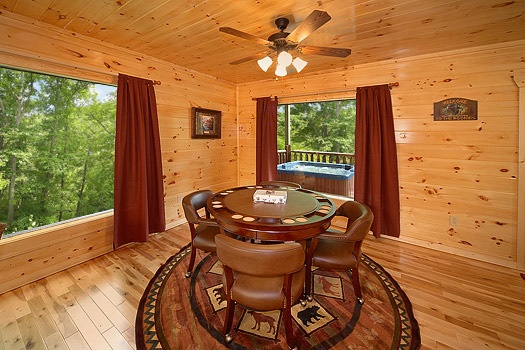 executive card table with four chairs in the game room at big bear cub house a 1 bedroom cabin rental located in gatlinburg
