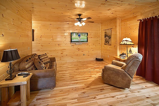 Family room on side of game room with love seat and recliner at Big Bear Cub House, a 1-bedroom cabin rental located in Gatlinburg