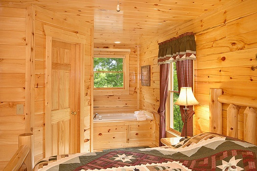 jacuzzi tub in master bedroom at big bear cub house a 1 bedroom cabin rental located in gatlinburg