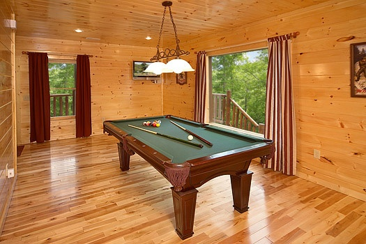 Green felted pool table in the game room at Big Bear Cub House, a 1-bedroom rental located in Gatlinburg