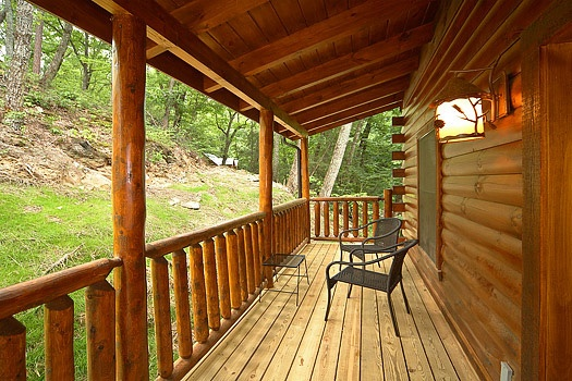 patio chairs on the rear deck at big bear cub house a 1 bedroom cabin rental located in gatlinburg