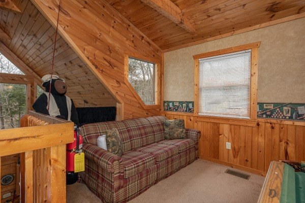 Sofa in the loft at Hooked on Bears, a 2 bedroom cabin rental located in Pigeon Forge