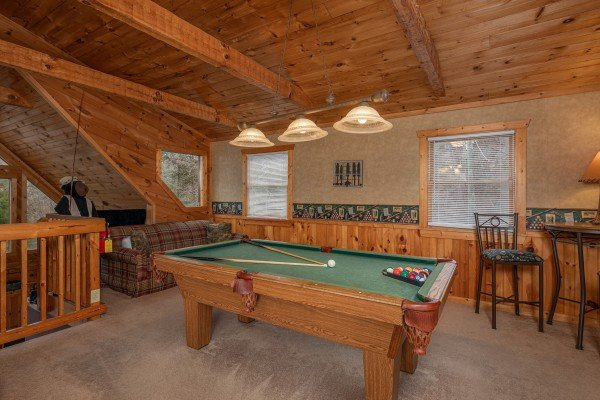 Pool table in the loft at Hooked on Bears, a 2 bedroom cabin rental located in Pigeon Forge