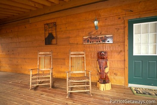Rocking chairs on the front porch at Hooked on Bears, a 2 bedroom cabin rental located in Pigeon Forge