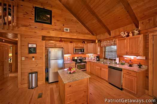 kitchen with stainless steel appliances at pigeon forge pleasures a 3 bedroom cabin rental located in pigeon forge
