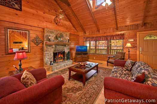 living room with fireplace at pigeon forge pleasures a 3 bedroom cabin rental located in pigeon forge