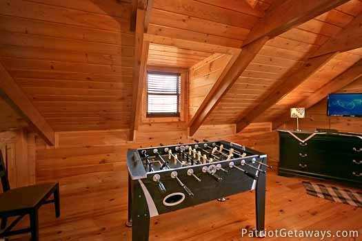 loft area with foosball table at pigeon forge pleasures a 3 bedroom cabin rental located in pigeon forge