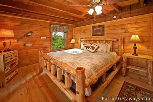 main level bedroom with king bed at pigeon forge pleasures a 3 bedroom cabin rental located in pigeon forge