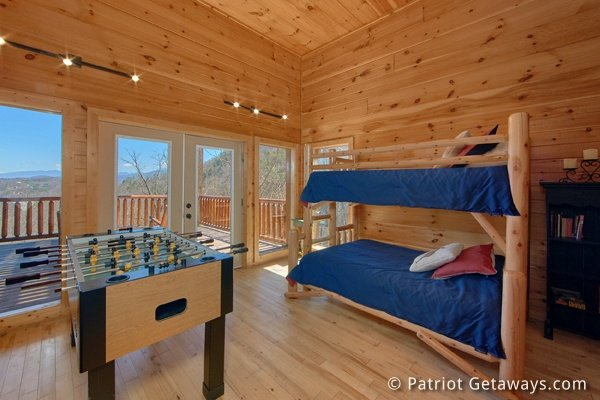 Bunk room and foosball table at Don't Blink! A 5-bedroom cabin rental located in Pigeon Forge