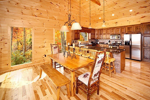 Dining area with large table at Don't Blink! A 5-bedroom cabin rental located in Pigeon Forge