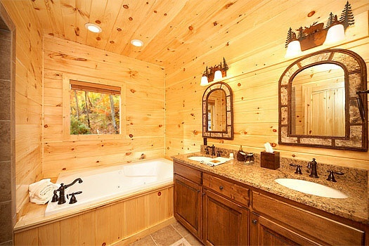 His and hers sinks connected to the king bedroom on the third floor at Don't Blink! A 5-bedroom cabin rental located in Pigeon Forge