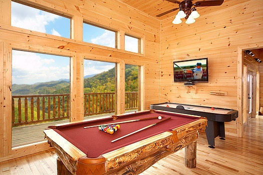 Game room with pool table and air hockey at Don't Blink! A 5-bedroom cabin rental located in Pigeon Forge