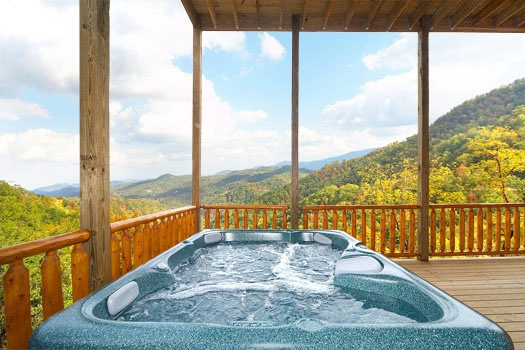 Hot tub on the deck with amazing mountain views of the Smokies at Don't Blink! A 5-bedroom cabin rental located in Pigeon Forge