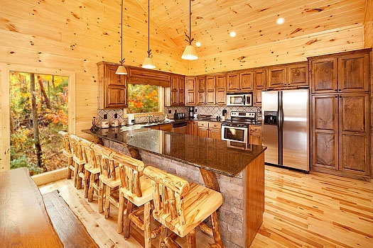 kitchen with six bar stools up to the counter at don't blink! a 5 bedroom cabin rental located in pigeon forge