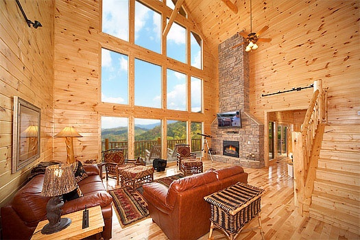 Windows touching the sky in the living room at Don't Blink! A 5-bedroom cabin rental located in Pigeon Forge