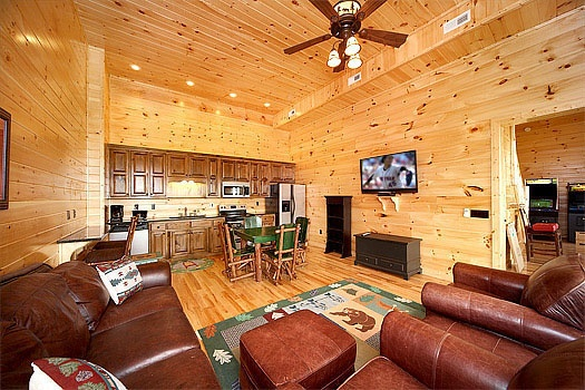 second kitchen and family room at don't blink! a 5 bedroom cabin rental located in pigeon forge