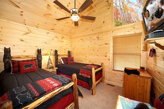 third floor bedroom with two twin sized beds at don't blink! a 5 bedroom cabin rental located in pigeon forge