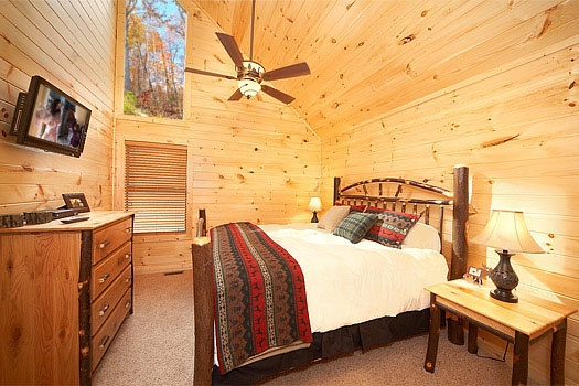Third floor bedroom with king-sized bed and chest of drawers at Don't Blink! A 5-bedroom cabin rental located in Pigeon Forge