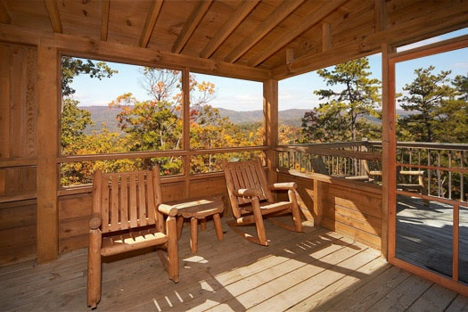 chairs in a screened deck at hooked on cowboys a 2 bedroom cabin rental located in pigeon forge
