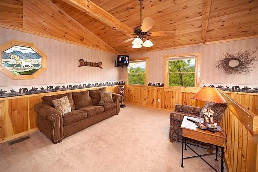 sofa bed in the loft at hooked on cowboys a 2 bedroom cabin rental located in pigeon forge