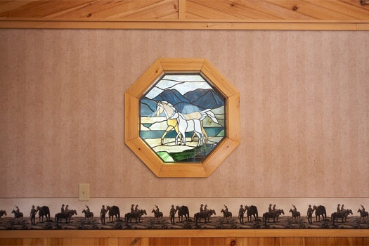 stained glass window of a horse at hooked on cowboys a 2 bedroom cabin rental located in pigeon forge