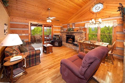 stone fireplace in the living room at hooked on cowboys a 2 bedroom cabin rental located in pigeon forge