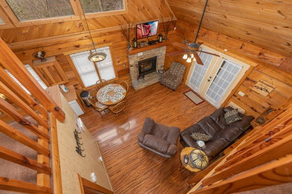 Looking down at the living room at Mickey's Playhouse, a 2 bedroom cabin rental located in Pigeon Forge
