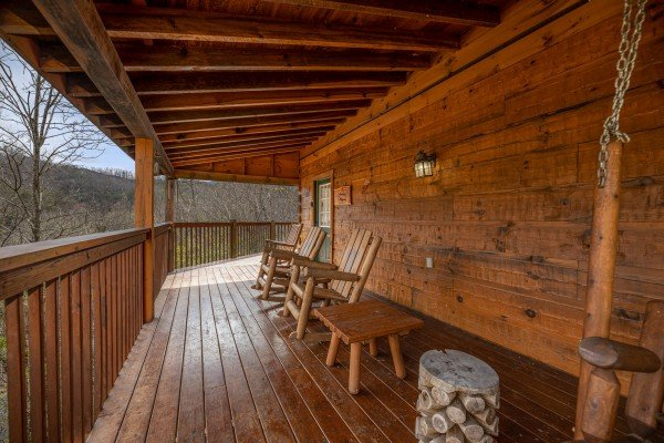 Covered porch at Mickey's Playhouse, a 2 bedroom cabin rental located in Pigeon Forge
