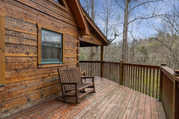 Bench on a deck at Mickey's Playhouse, a 2 bedroom cabin rental located in Pigeon Forge