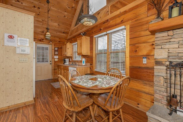 Dining table for four at Mickey's Playhouse, a 2 bedroom cabin rental located in Pigeon Forge