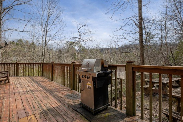 Grill on the deck at Mickey's Playhouse, a 2 bedroom cabin rental located in Pigeon Forge