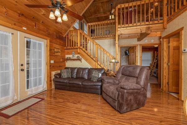Sofa and chair in the living room at Mickey's Playhouse, a 2 bedroom cabin rental located in Pigeon Forge
