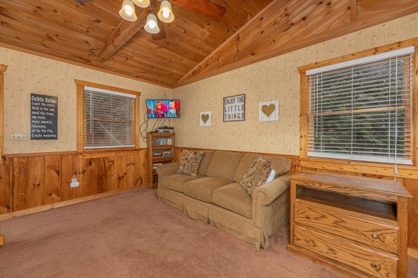Sleeper sofa and TV in the loft at Mickey's Playhouse, a 2 bedroom cabin rental located in Pigeon Forge