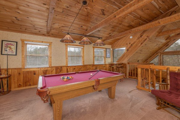 Pool table in the loft at Mickey's Playhouse, a 2 bedroom cabin rental located in Pigeon Forge