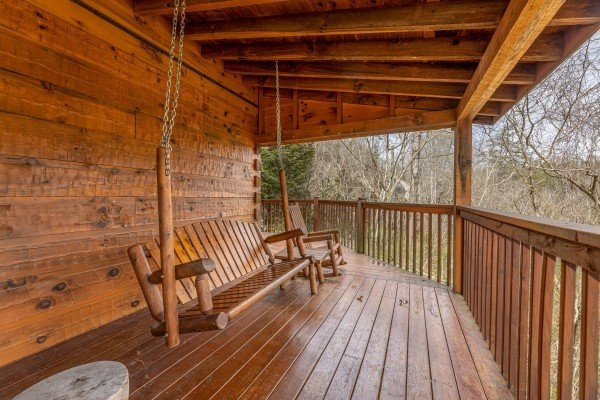 Porch swing at Mickey's Playhouse, a 2 bedroom cabin rental located in Pigeon Forge