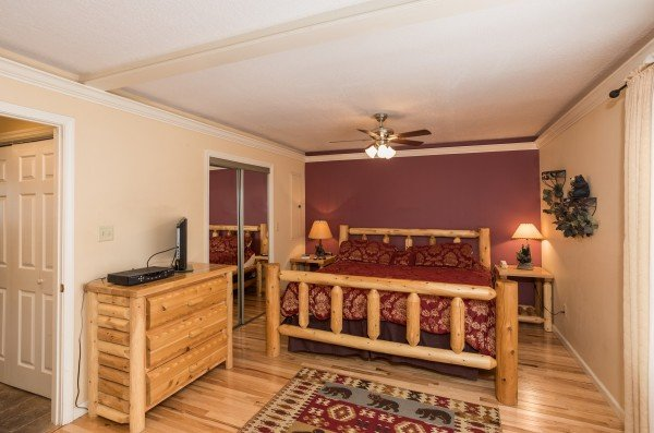 Bedroom with dresser, night stands, and lamps at Mountain Laurel, a 1 bedroom cabin rental located in Gatlinburg