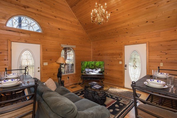 Living room with TV and dining set at Mountain Laurel, a 1 bedroom cabin rental located in Gatlinburg