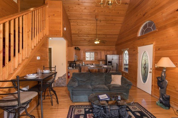 Living room with bistro set at Mountain Laurel, a 1 bedroom cabin rental located in Gatlinburg