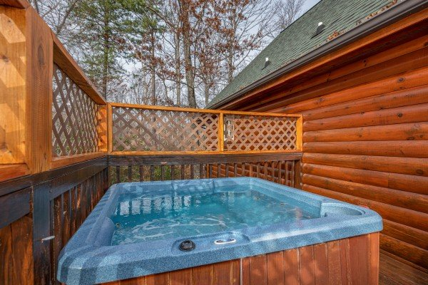Hot tub on the deck is near at Mountain Laurel, a 1 bedroom cabin rental located in Gatlinburg