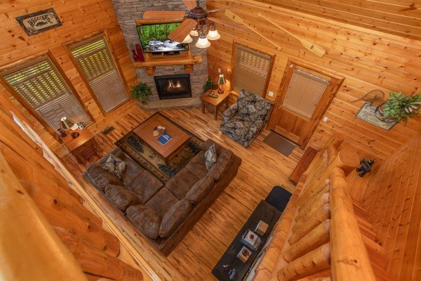 Looking down into the living room at Mountain Adventure, a 2 bedroom cabin rental located in Pigeon Forge
